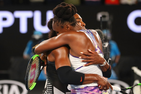 Serena (L) and Venus Williams embrace at the net after their 2017 Australian Open final, the first time they have met in a major final since 2009. | Photo: Scott Barbour/Getty Images