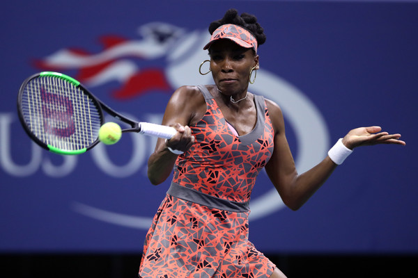 Venus Williams hits a forehand during the match | Photo: Matthew Stockman/Getty Images North America