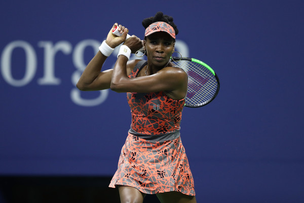 Venus Williams hits a backhand during the match | Photo: Elsa/Getty Images North America