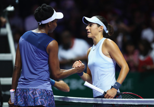 Garcia congratulates Williams at the net after the encounter | Photo: Clive Brunskill/Getty Images AsiaPac