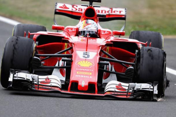O pneu furado de Vettel no fim lhe custou um pódio e a boa vantagem no campeonato (Foto: Mark Thompson/Getty Images)