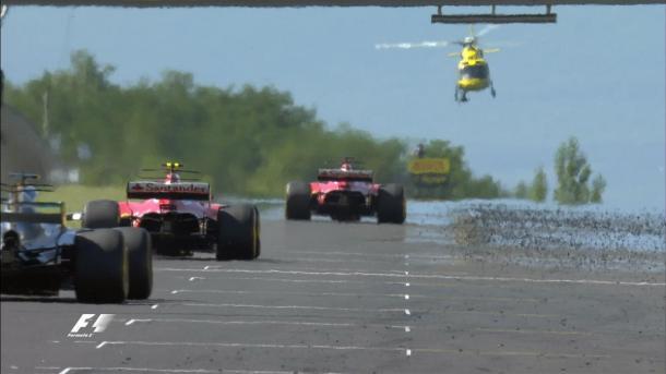 Vettel, Räikkönen e Hamilton ficaram um bom tempo colados no fim da prova (Foto: Divulgação/F1)