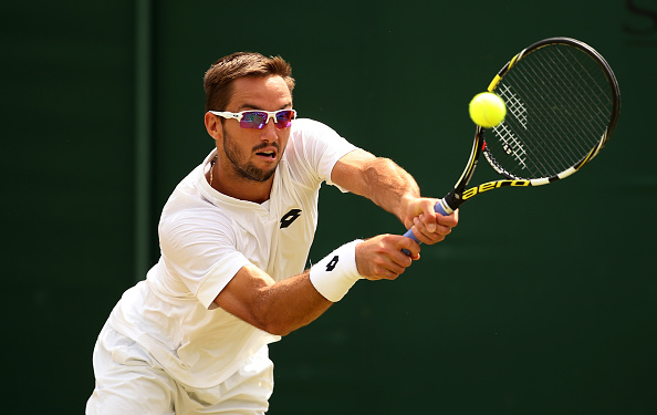 Troicki plays a backhand in his Gentlemen's Singles Fourth Round match against Vasek Pospisil of Canada during day seven of the Wimbledon Lawn Tennis Championships at the All England Lawn Tennis and Croquet Club on July 6, 2015 in London, England. (Photo by Ian Walton/Getty Images)