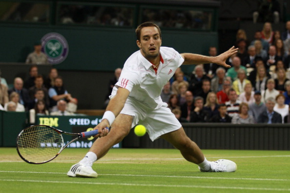 Troicki hits a forehand return during his Gentlemen's Singles fourth round match against Novak Djokovic of Serbia on day seven of the Wimbledon Lawn Tennis Championships at the All England Lawn Tennis and Croquet Club on July 2, 2012 in London, England.