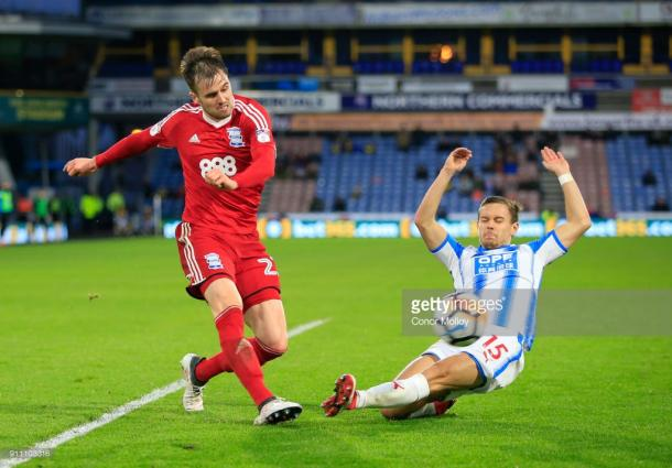27th January 2018, John Smith's Stadium, Huddersfield, England; FA Cup football, 4th round, Huddersfield Town versus Birmingham City; Carl Jenkinson of Birmingham City crosses the ball under pressure from Chris Lowe of Huddersfield Town (Photo by Conor Molloy/Action Plus via Getty Images)