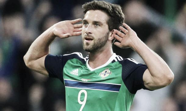 Will Grigg celebrates against Belarus. | Image source: Getty Images