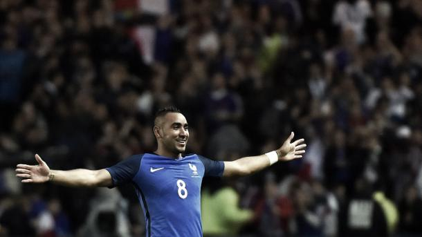 Above: Dimitri Payet celebrates his goal in France's 3-2 win over Cameroon
