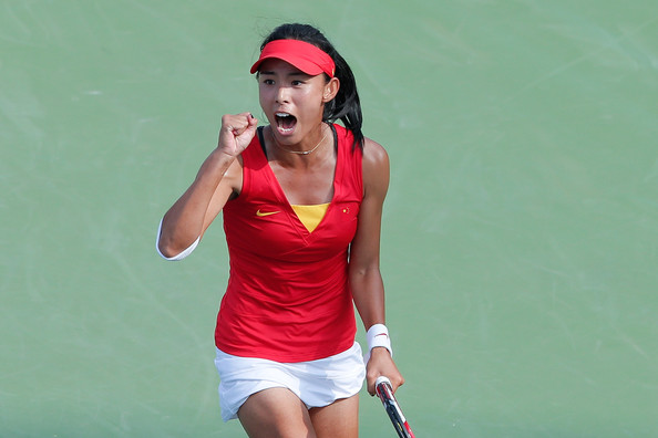 Wang Qiang celebrating a point won during the 2014 Asian Games | Photo: Lintao Zhang/Getty Images AsiaPac