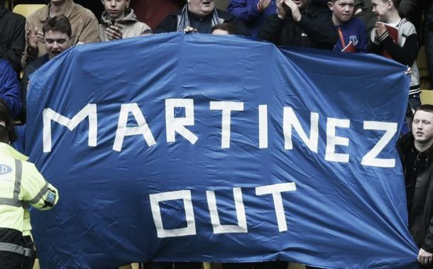 Everton supporters displayed their frustration and anger at Vicarage Road earlier this month. | Photo: Getty Images