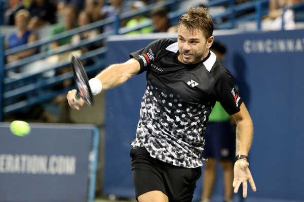 Stan Wawrinka crushes one of his giant backhands against Federer. Photo: Rob Carr/Getty Images