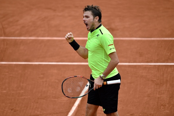 Stan Wawrinka roars after winning the third set. Photo: Philippe Lopz/AFP/Getty Images