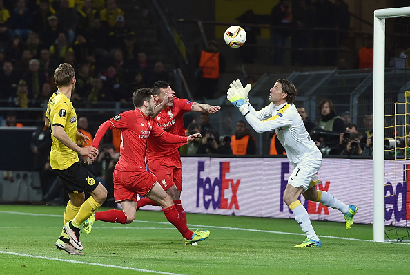 Roman Weidenfeller comes forth to collect the ball ahead of Dejan Lovren and Adam Lallana. (Getty)