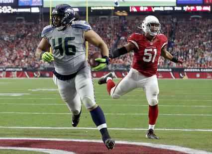 Will Tukuafu scored a touchdown against the Arizona Cardinals on the final game of the 2015 NFL season | Source: Ross D. Franklin - AP Photo