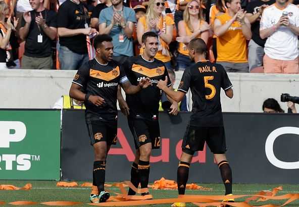 Giles Barnes (L) of Houston Dynamo celebrates with Will Bruin (C) and Raul Rodriguez (R) after scoring against the New England Revolution / Bob Levey -Getty Images