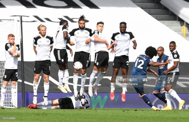 Willian hits a free-kick against Fulham during the Premier League match between Fulham and Arsenal at Craven Cottage. (Photo by Stuart MacFarlane/Arsenal FC via Getty Images)