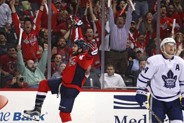 Tom Wilson (in red) celebrates his overtime winner. Photo: Patrick Smith/Getty Images