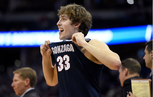 Kyle Wiltjer (33) of the Gonzaga Bulldogs pops his jersey in the waning seconds against the Utah Utes during the second half of Gonzaga's 82-59 second round NCAA Tournament game win on Saturday, March 19, 2016. (Photo by AAron Ontiveroz/The Denver Post via Getty Images