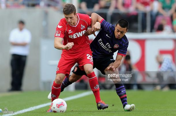 Wimmer plays in a pre-season friendly against Arsenal in 2012. Source | Getty Images.