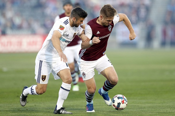 Real Salt Lake's Chris Wingert challenges Colorado Rapids' Kevin Doyle for the ball. | Photo: David Zalubowski, AP Photo