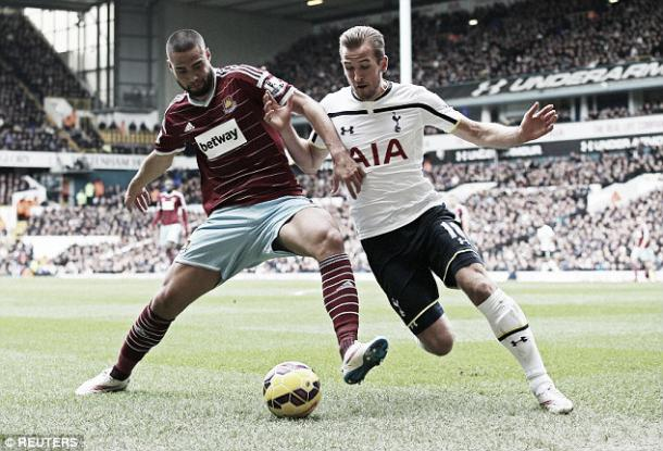 Winston Reid battles with Harry Kane in the 2014/15 season (Reuters)