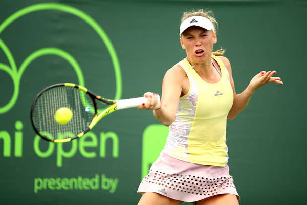 Caroline Wozniacki hits a forehand during her second round match against Vania King at the Miami Open/Getty Images