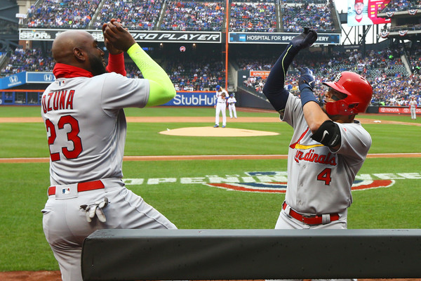 Yadier Molina (r.) celebrates with Marcell Ozuna (l.) after his two-run blast gave the Cardinals a 2-1 lead/Photo: Mike Stobe/Getty Images