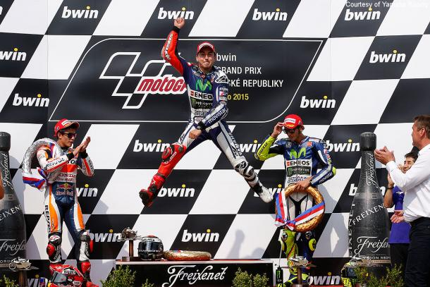 Lorenzo celebrates his top place on the podium at the 2015 Brno GP - www.motorcycle-usa.com