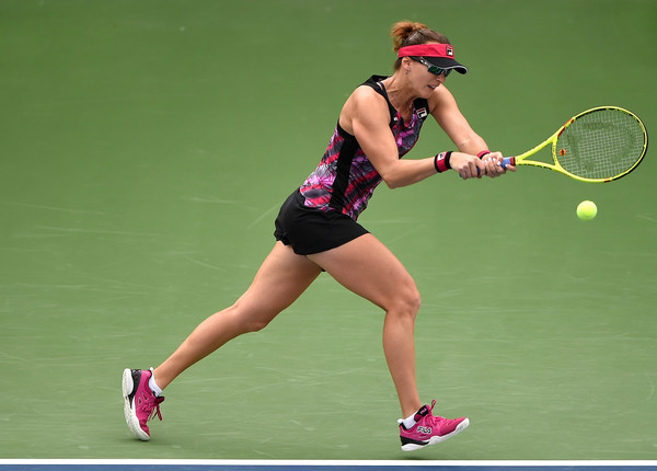 Yaroslava Shvedova hits a backhand during her first-round match against Monica Puig at the 2017 Dubai Duty-Free Tennis Championships.   Photo: Tom Dulat/Getty Images
