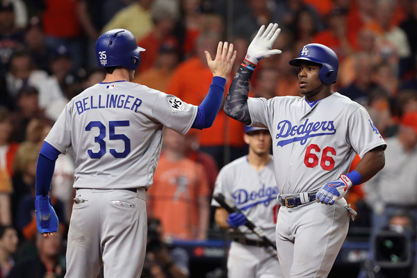 Puig celebrates with Bellinger after his ninth-inning homer brought the Dodgers to within one/Photo: Christian Petersen/Getty Images