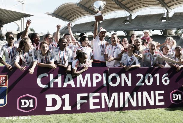 Lyon celebrate their league title. | Image source: UEFA
