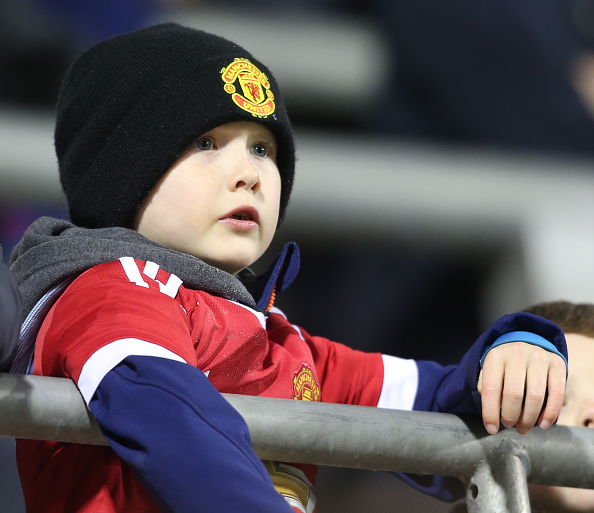A young United fan watches on | Photo: John Peters/Manchester United