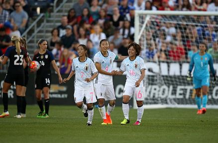 Yuki Nagasato (center - #9) celebrates after scoring on the USWNT during a friendly in June of 2016 | Source: Doug Pensinger - Getty Images