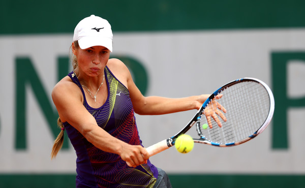 Yulia Putintseva hits a drop shot at the French Open in Paris/Getty Images: Julian Finney