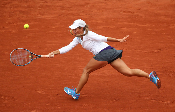 Yulia Putintseva slides for a forehand at the French Open in Paris/Getty Images: Clive Brunskill