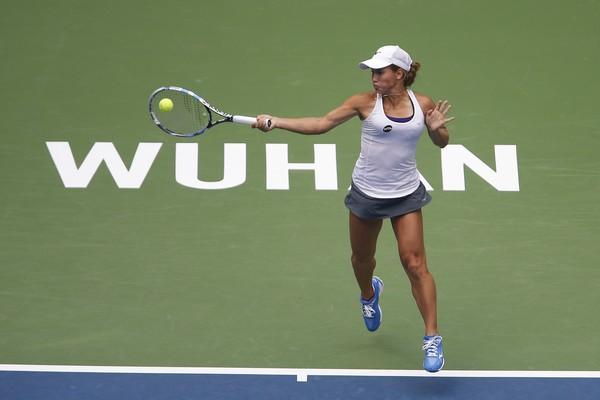 Yulia Putintseva hits a forehand at the Dongfeng Motor Wuhan Open/Getty Images: Wang He