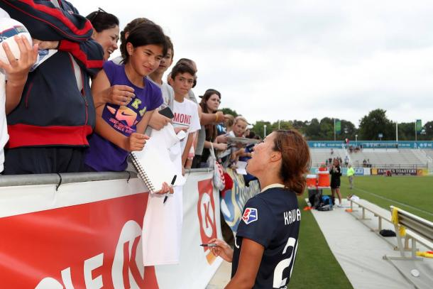 Yuri Kawamura signs autographs for some fans after a game | Source: North Carolina Courage Facebook Page