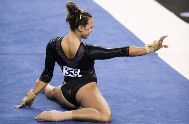 Ashleigh Gnat finishes off her floor routine with a tiger paw at the NCAA Women's Gymnastics Championships/LSU Sports