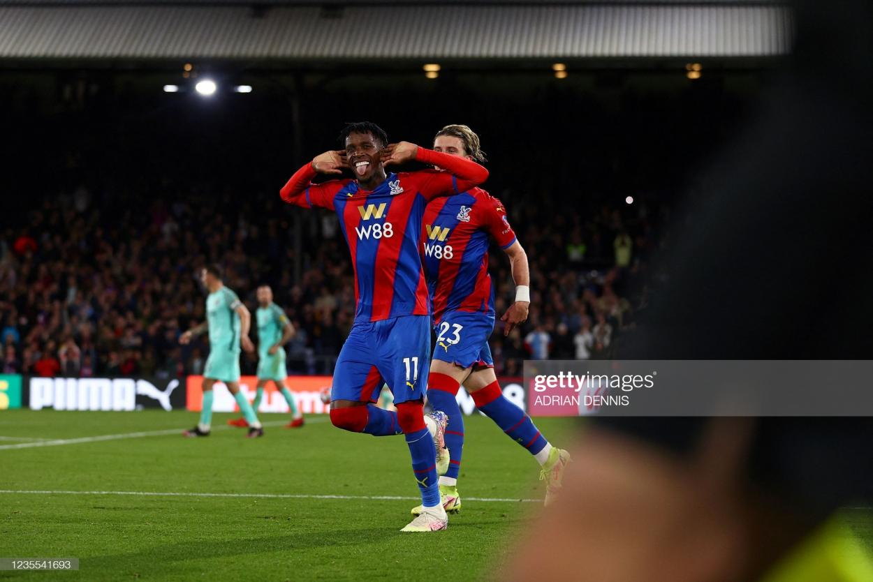 Premature celebrations. Zaha turns to the Palace faithful after putting them ahead | Photo by Adrian Dennis/AFP via Getty Images
