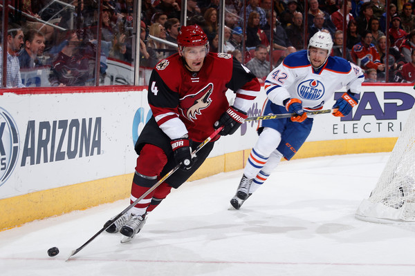 Zbynek Michalek #4 of the Arizona Coyotes skates with the puck ahead of Anton Slepyshev #42 of the Edmonton Oilers during the second period of the NHL game at Gila River Arena on November 12, 2015 in Glendale, Arizona. (Nov. 11, 2015 - Source: Christian Petersen/Getty Images North America)