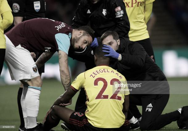 Marvin Zeegelaar receives treament after being introduced to Andy Carroll (Photo: Avril Husband / getty Images)