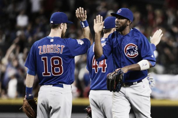 Ben Zobrist and Dexter Fowler high five each other after defeating the Arizona Diamondbacks (AP Photo)