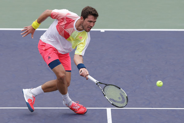 Mischa Zverev hits a low forehand during his third round match. Photo: Lintao Zhang/Getty Images