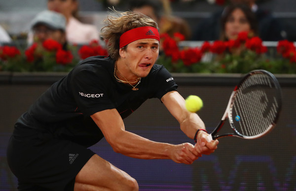 Alexander Zverev chases down a backhand during his semifinal win in Madrid. Photo: Clive Brunskill/Getty Images