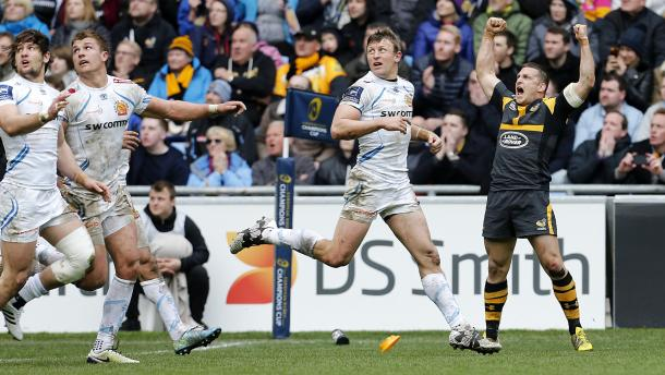 Wasps', Jimmy Gopperth, celebrates his Champions Cup overtime conversion, as Chiefs players look on in their agonising 25-24 European defeat. (image via wasps)