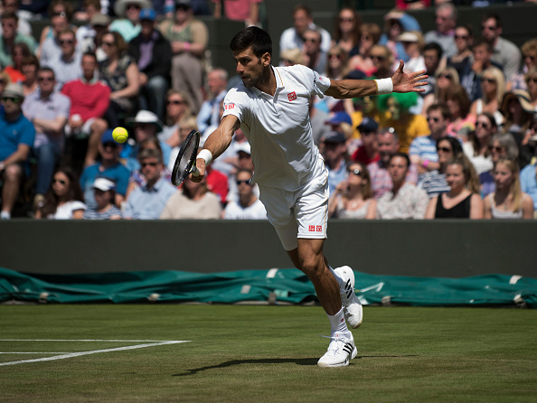 Novak Djokovic stretching for a shot (Photo: Icon Sportswire)
