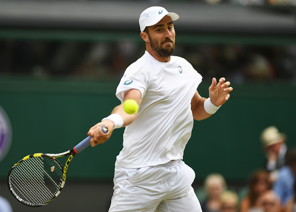Steve Johnson strikes a forehand shot (Photo: Shaun Botterill/Getty Images)