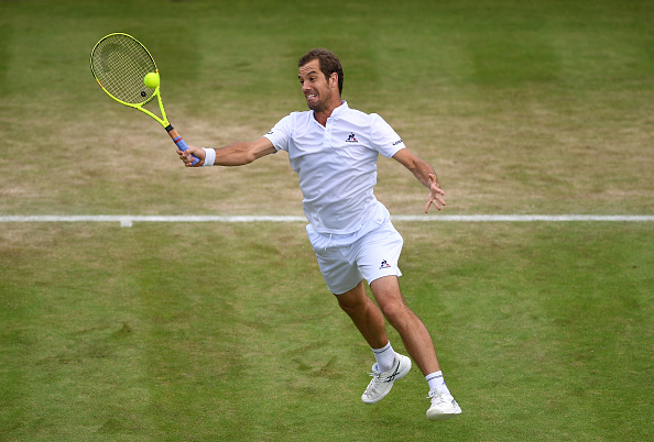 Richard Gasquet goes for a volley (Photo: Shaun Botterill/Getty Images)