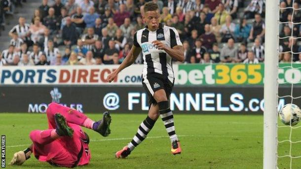 Gayle rolls the ball past Al Habsi for his second of the night (Photo: bbc)