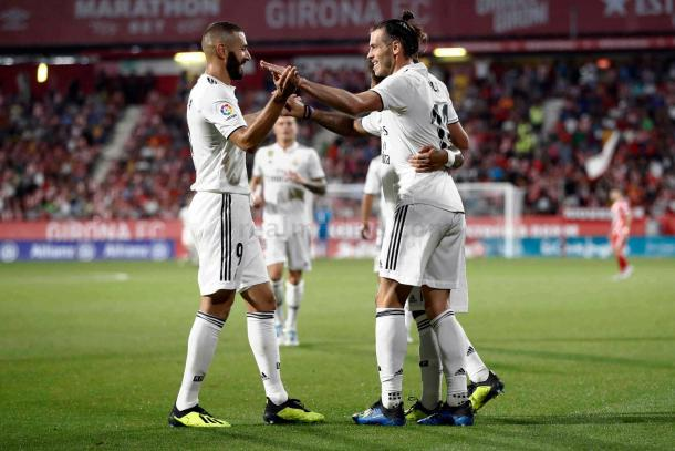 Principais nomes da partida, Gareth Bale e Karim Benzema comemoram um dos gols do Real (Foto: Divulgação/Real Madrid)