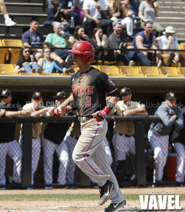 Roman Baisa (3) crosses the plate to score the first run for Ball State. Photo: Walter Cronk